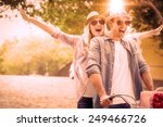 Stock photo hip young couple going for a bike ride on a sunny day in the city 249466726