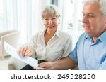 senior couple read the form for ... | Shutterstock . vector #249528250