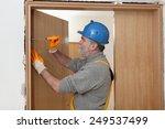 worker fix door hinge with...   Shutterstock . vector #249537499