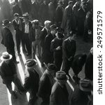unemployed men wait in line to... | Shutterstock . vector #249571579