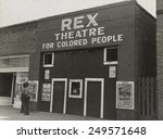 Small photo of Segregated movie theater for African Americans in Leland, Mississippi, Nov. 1939. 'Rex Theatre for Colored People' advertised the official film of Joe Louis-Bob Paster fight