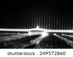 Small photo of Grand review on the searchlight-illuminated Zeppelin field at Nuremberg Rally. Sept. 1937. Albert Speer designed the Cathedral of light in which 152 searchlights cast vertical beams into the sky.