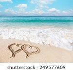 Hearts Drawn On The Beach Sand.