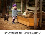 little girl on a farm with... | Shutterstock . vector #249682840