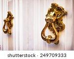 Old Doorknocker At A Door