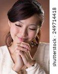 Asian Woman Praying  Closeup...