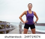 sporty young woman standing on... | Shutterstock . vector #249719074