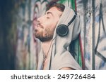 young hipster gay man listening