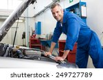 mechanic working under the hood ... | Shutterstock . vector #249727789