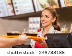 Restaurant worker serving two...