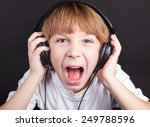 young boy's singing with... | Shutterstock . vector #249788596