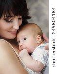 portrait of young happy mother... | Shutterstock . vector #249804184