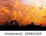 Sunset Clouds Over Dark Horizon