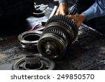 Engineer Hands Fixing Engine...