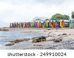 Multi Colored Beach Huts At St...