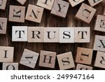 Small photo of text of TRUST on cubes