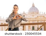happy young woman showing heart ... | Shutterstock . vector #250045534