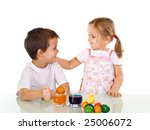 Happy kids dyeing the easter eggs - isolated - stock photo
