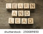 learn and lead text on a wooden ... | Shutterstock . vector #250089850