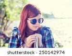pensive beautiful young woman... | Shutterstock . vector #250142974