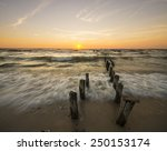 sea beach and breakwater at... | Shutterstock . vector #250153174