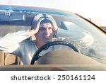 young man in traffic congestion | Shutterstock . vector #250161124