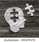 Stock photo puzzle head brain concept as a human face profile made from crumpled white paper with a jigsaw 250199170