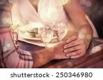 couple holding hands at dinner... | Shutterstock . vector #250346980