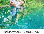 Woman Meditating At Pool Side....
