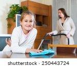 little smiling girl dusting and ... | Shutterstock . vector #250443724