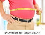 close up on a man measuring his ... | Shutterstock . vector #250465144