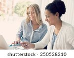 Small photo of Two women working together in office
