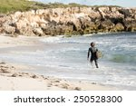 a surfer with his surfboard at... | Shutterstock . vector #250528300