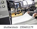 worker preparing large white...   Shutterstock . vector #250601179