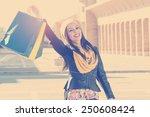 beautiful girl with shopping...   Shutterstock . vector #250608424