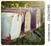 rusty us mailboxes in the... | Shutterstock . vector #250625980