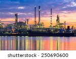 oil refinery reflected on river ... | Shutterstock . vector #250690600