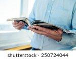 a man looks at a magazine....   Shutterstock . vector #250724044
