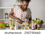 young african woman cooking.... | Shutterstock . vector #250750660