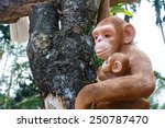 Statue Of A Monkey Hold Baby