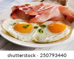 two fried eggs and bacon for... | Shutterstock . vector #250793440