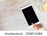 tablet computer on table | Shutterstock . vector #250871080