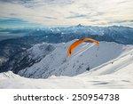 Paraglider Flying On Snowy...
