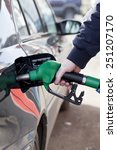 man filling up car with fuel at ... | Shutterstock . vector #251207170