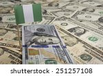 Flag Of Nigeria Sticking In A...