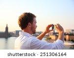 Постер, плакат: Tourist taking photograph of