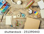 Desk Of An Artist With Lots Of...