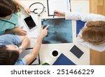 doctors sitting around the... | Shutterstock . vector #251466229