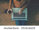 laptop and coffee cup in girl's ... | Shutterstock . vector #251616610