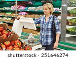 woman weighing vegetables in... | Shutterstock . vector #251646274